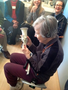Tour participant with low vision touching the 3D printed Sheep Rhyton.